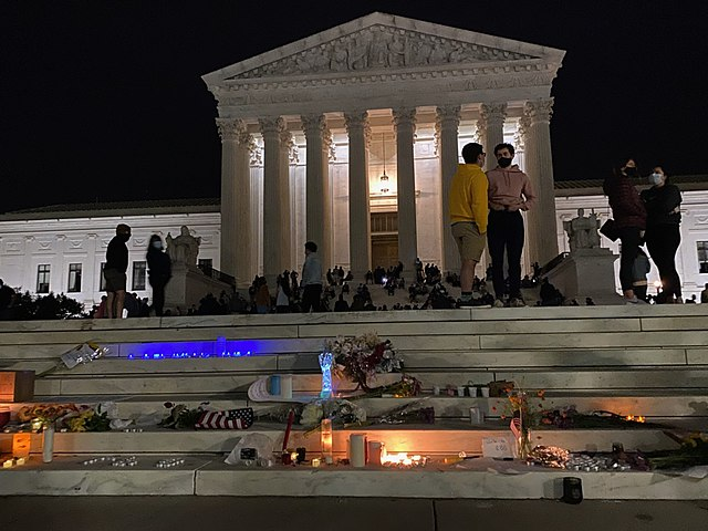 A candlelit makeshift memorial on the steps of the US Supreme Court following the death of Ruth Bader Ginsburg. Photo Credit: Ben J
